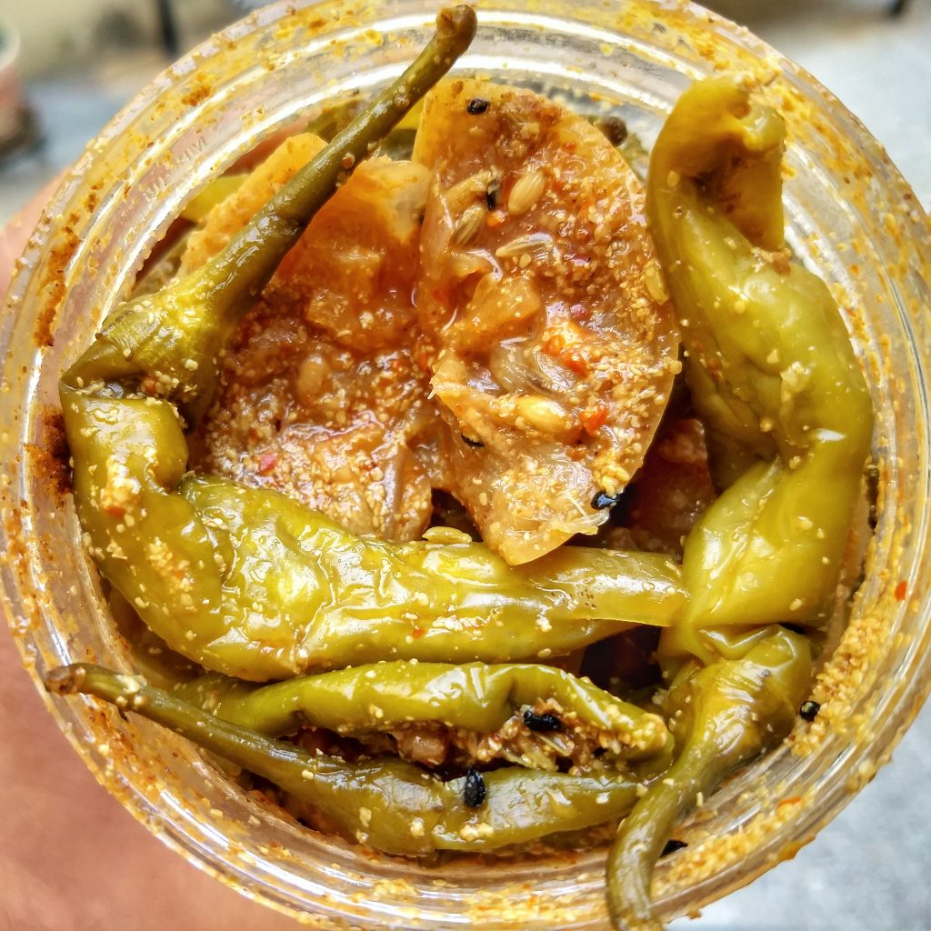 Green chillies and whole lemon pickle in classic pure vegetarian baniya style